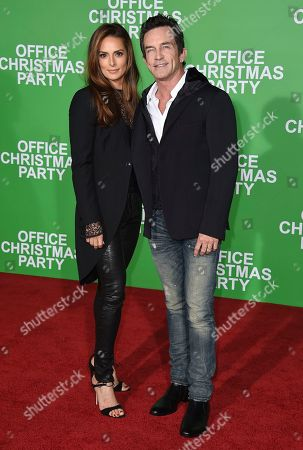 """Jeff Probst, right, and Lisa Ann Russell arrive at the Los Angeles premiere of """"Office Christmas Party"""" at the Village Theatre Westwood on"""