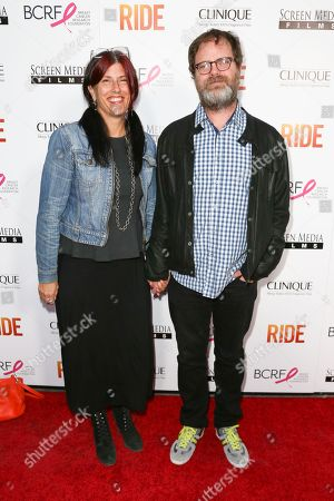 """Holiday Reinhorn, left, and Rainn Wilson arrive at the LA Premiere of """"Ride"""" at The Arclight Hollywood Theater, in Los Angeles"""