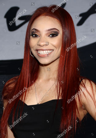 "Erin Bria Wright, daughter of rapper Eazy-E, arrives at the Los Angeles premiere of ""Straight Outta Compton"" at the Microsoft Theater on"