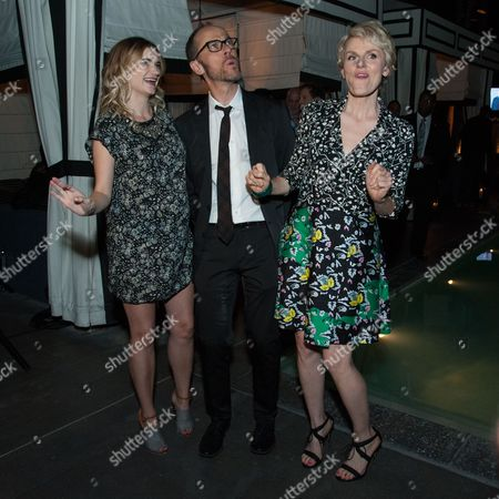 """Stock Image of Megan Ferguson, from left, Executive Producer/ Writer/ Showrunner Ben Wexler, and Stephnie Weir attend the After Party for the LA Premiere of FX's """"The Comedians"""", in Santa Monica, Calif"""