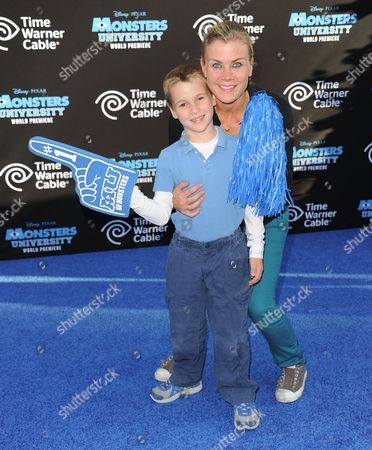 """Benjamin Sanov, left, and Alison Sweeney arrive at the LA premiere of """"Monsters University"""" at the El Capitan Theatre on in Los Angeles"""