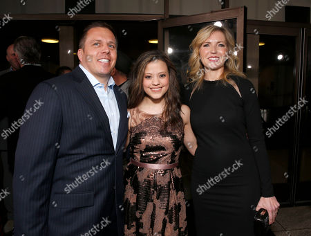 """SVP of DirecTV Entertainment Chris Long, Sarah Jeffery and Vice President and General Manager of Audience Network Patty Ishimoto arrive at the LA premiere of """"Rogue"""" at the ArcLight Hollywood on in Los Angeles"""