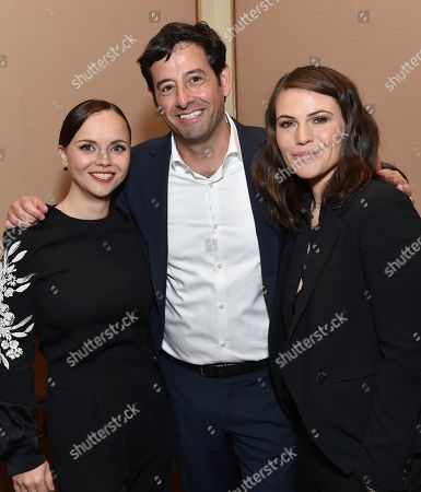 "Rob Sharenow, executive vice president and general manager of Lifetime, center, and from left, Christina Ricci and Clea DuVall, of Lifetime's ""The Lizzie Borden Chronicles"", pose backstage at the Lifetime, A&E, and History winter TCA panel at the Langham Hotel, in Pasadena, Calif"
