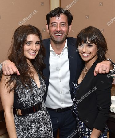 """Rob Sharenow, executive vice president and general manager of Lifetime, center, from left, Shiri Appleby, and Constance Zimmer, of Lifetime's """"Un-Real"""", pose backstage at the Lifetime, A&E, and History winter TCA panel at the Langham Hotel, in Pasadena, Calif"""
