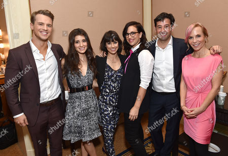 "Rob Sharenow, executive vice president and general manager of Lifetime, second from right, and from left, Freddie Stroma, Shiri Appleby, Constance Zimmer, Sarah Gertrude Shapiro, co-creator and supervising producer, Marti Noxon, co-creator and executive producer, of Lifetime's ""Un-Real"", pose backstage at the Lifetime, A&E, and History winter TCA panel at the Langham Hotel, in Pasadena, Calif"