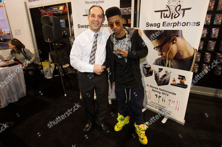 "Stock Photo of Vice preseident of Nikura USA, David Mosseri with Hip hop artist, ""Lil Twist"" seen at International CES 2013, on in Las Vegas, NV for the debut of his new headphone collection ""Twist Swag Headphones by Nikura USA"