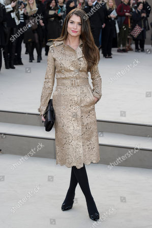 Stock Image of Alinne Moraes arrives for the Burberry Prorsum fashion collection during London Fashion Week, at a central London Venue, London