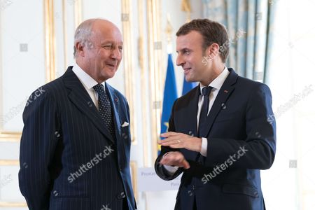 President of Constitutional Council Laurent Fabius and French President Emmanuel Macron