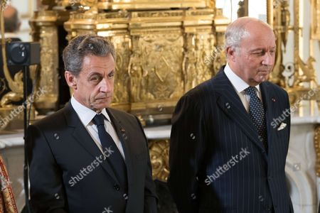 Former French President Nicolas Sarkozy and Laurent Fabius
