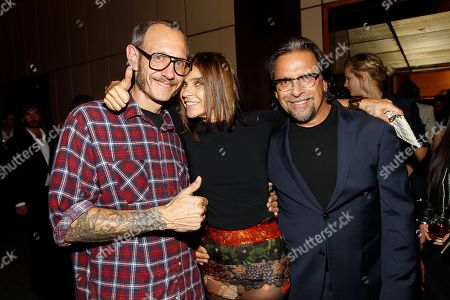 Vladimir Restoin-Roitfeld, Carine Roitfeld, and Sante D'Orazio attend the after party for the New York premiere of Mademoiselle C presented by Cohen Media and sponsored by Absolute Elyx, LoveGold, and The Hollywood Reporter at the Four Season Restaurant on in New York