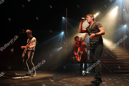 Kyle Cook,Brian Yale and Rob Thomas of Matchbox 20 perform at the Seminole Hard Rock Hotel and Casinos' Hard Rock Live on in Hollywood, Florida