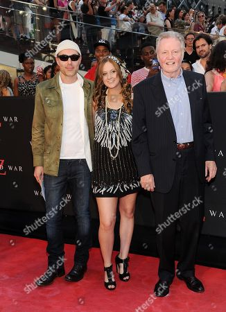 "Angelina Jolie's brother and father, from left, James Haven and his girlfriend Ashley Reign arrive with actor Jon Voight at the premiere of ""World War Z"" in Times Square on in New York"
