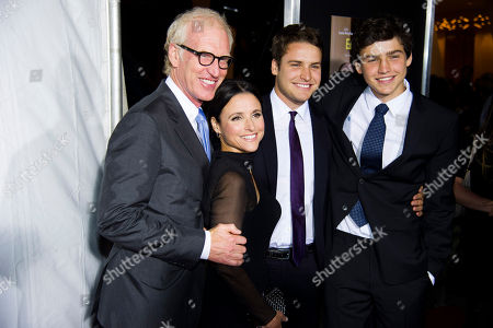 """Julia Louis-Dreyfus, husband Brad Hall, sons Charles Hall, right, and Henry Hall attend a special screening of """"Enough Said"""" on in New York"""