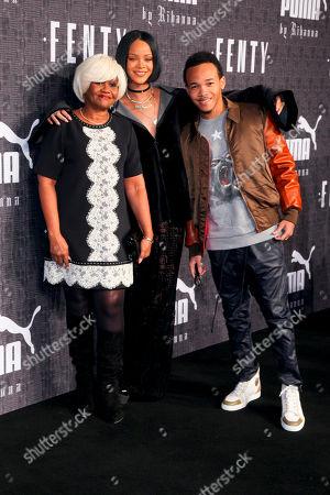 Monica Braithwaite, from left, Rihanna and Rajad Fenty attend the FENTY PUMA by Rihanna fashion show at 23 Wall Street, in New York