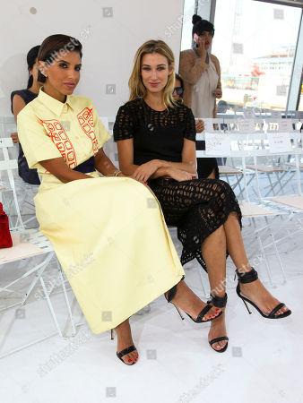 Deena Abdulaziz, left, and Lauren Remington Platt, right, attend the New York Fashion Week Spring/Summer 2016 Delpozo fashion show, in New York