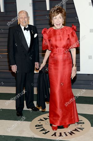 Betsy Bloomingdale, right, and a guest arrive at the 2015 Vanity Fair Oscar Party in Beverly Hills, Calif. Bloomingdale, the widow of a department store heir who hobnobbed with the world's elite and was best friends with Nancy Reagan, has died. She was 93. Her daughter-in-law says Bloomingdale died, at her Los Angeles home from congestive heart failure