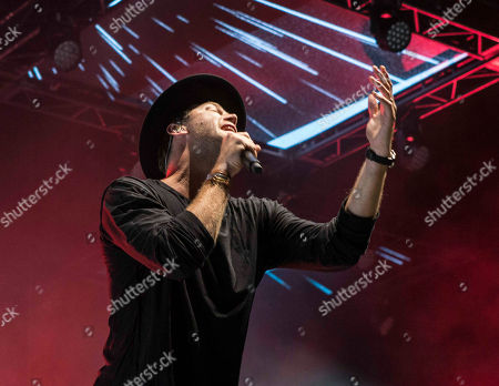 Stock Photo of Joel Houston with Hillsong UNITED performs during the Outcry Tour 2015 at Verizon Wireless Amphitheatre, in Atlanta