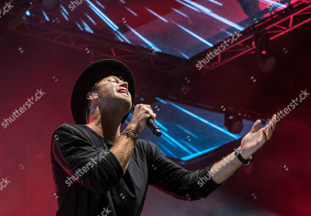 Joel Houston with Hillsong UNITED performs during the Outcry Tour 2015 at Verizon Wireless Amphitheatre, in Atlanta
