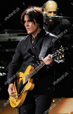 "Rusty Anderson performs with Paul McCartney band during the Out There"" Tour at the Times Union Center, in Albany, N.Y"