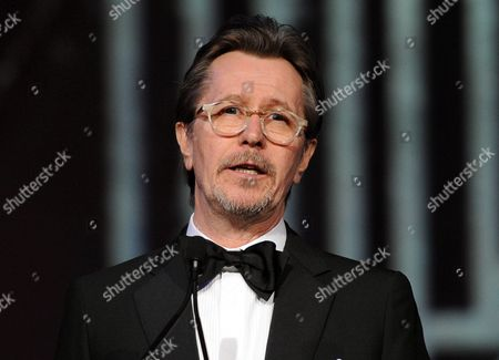 Actor Gary Oldman speaking at the Palm Springs International Film Festival Awards Gala at the Palm Springs Convention Center in Palm Springs, Calif. A Los Angeles judge finalized Oldman's divorce from his fourth wife, singer Alexandra Edenborough,, court records show. The Oscar-nominated actor will pay Edenborough $3.3 million as part of their judgment, which ends a six-year marriage