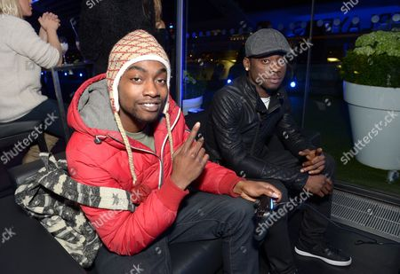 Stock Image of Stylo G (right) and a guest attends an exclusive preview at the OXO Tower to celebrate the arrival of PlayStation4 in the UK,, in London