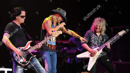SUNRISE, FL - AUGUST 9: Bobby Dall,Bret Michaels and C.C. DeVille of Poison perform during the Rock of Ages Tour 2012 at the Bank Atlantic Center on in Sunrise, Florida