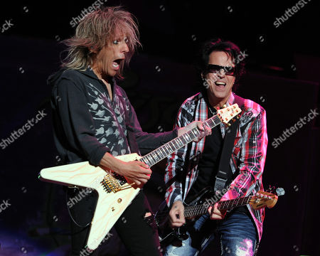 SUNRISE, FL - AUGUST 9: C.C. DeVille and Bobby Dall of Poison perform during the Rock of Ages Tour 2012 at the Bank Atlantic Center on in Sunrise, Florida