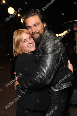 """Executive producer Sarah Condon, left, and Jason Momoa attend the premiere screening of SundanceTV's """"The Red Road"""", on in Los Angeles"""