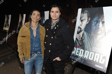 """Stock Image of Zahn McClarnon, left, and Kiowa Gordon arrive at the premiere screening of SundanceTV's """"The Red Road"""", on in Los Angeles"""