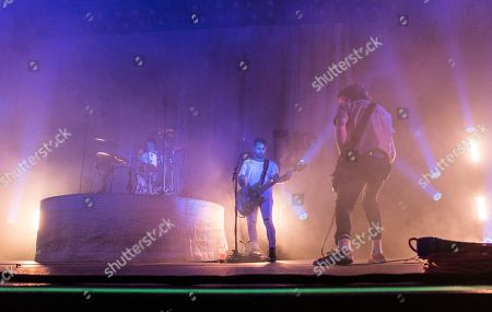 Aaron Bruno, Kenny Carkeet, Zach Irons, Isaac Carpenter and Marc Walloch with AWOLNATION performs during the Radio 105.7 Holiday Spectacular at the Tabernacle, in Atlanta
