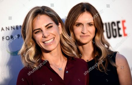 """Fitness trainer Jillian Michaels and her partner Heidi Rhoades pose together at the opening of the new photography exhibit """"REFUGEE"""" at The Annenberg Space for Photography, in Los Angeles"""