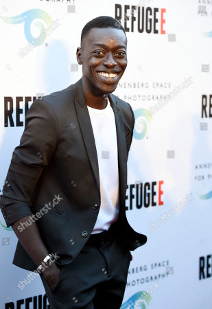 """Stock Picture of Photographer Omar Victor Diop poses at the opening of the new photography exhibit """"REFUGEE"""" at The Annenberg Space for Photography, in Los Angeles"""