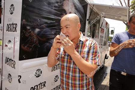 """CS Lee at the Showtime Dexter Coolhaus Ice Cream Truck, on Sunday, June, 23, 2013 in Venice, CA. For the launch of the eighth and final season of Dexter and as part of its For Your Consideration Emmy Award campaign, SHOWTIME distributes free Dexter """"Killer Combo"""" Ice Cream Sandwiches in Los Angeles and New York"""