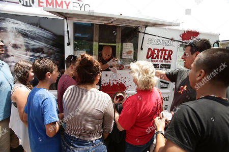 """CS Lee and Fans at the Showtime Dexter Coolhaus Ice Cream Truck, on Sunday, June, 23, 2013 in Venice, CA. For the launch of the eighth and final season of Dexter and as part of its For Your Consideration Emmy Award campaign, SHOWTIME distributes free Dexter """"Killer Combo"""" Ice Cream Sandwiches in Los Angeles and New York"""