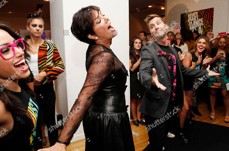 IMAGE DISTRIBUTED FOR UBISOFT -Lance Bass and Kris Jenner play the Just Dance 4 video game at the Just Dance 4 Fashion Show, in New York