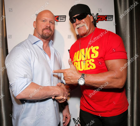Stock Picture of WWE Hall of Famers Stone Cold Steve Austin and Hulk Hogan pose for a photo at the SummerSlam Confidential Panel to reveal the WWE 2K15 roster at Club Nokia, on in Los Angeles