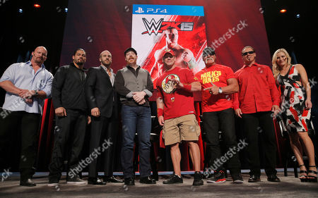 SummerSlam Confidential Panel participants pose for a photo after announcing the WWE 2K15 roster. From left to right: WWE Hall of Famer Stone Cold Steve Austin, WWE Superstars Roman Reigns, Cesaro, Sheamus and John Cena, WWE Hall of Famer Hulk Hogan, iconic competitor Sting and WWE broadcaster Renee Young at Club Nokia, on in Los Angeles
