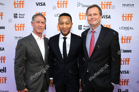 """Jon Feltheimer, Chief Executive Officer of Lionsgate, John Legend and Michael Burns, Vice President of Lionsgate, seen at Summit Entertainment's """"La La Land"""" premiere at the 2016 Toronto International Film Festival, in Toronto"""