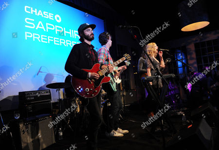"""The group JJAMZ, from left, Alex Greenwald, Michael Reunion, Z Berg, Jason Boesel, and James Valentine perform at the """"Touchy Feely"""" premiere party at The Shop during the Sundance Film Festival on in Park City, Utah"""
