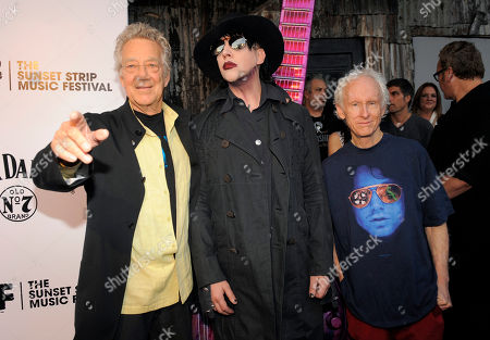 Ray Manzarek, left, and Robby Krieger, right, two of the original members of The Doors, pose with Marilyn Manson at the Sunset Strip Music Festival launch party celebrating The Doors at the House of Blues on in West Hollywood, Calif