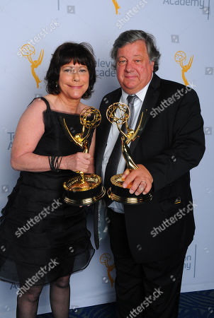 "Stock Picture of Karen Goodman, left, and Kirk Simon, winners of the award for outstanding children's program for ""Alan Alda and the actor within you: a youngarts masterclass"", pose for a portrait at the Television Academy's Creative Arts Emmy Awards at Microsoft Theater, in Los Angeles"