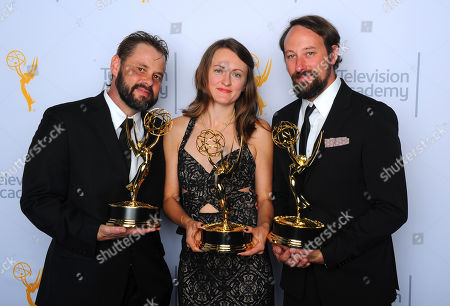 "Tyler Robinson, from left, Katherine Isom and Schuyler Telleen, winners of the award for outstanding production design for a variety, nonfiction, reality or reality competition program for ""Portlandia"", pose for a portrait at the Television Academy's Creative Arts Emmy Awards at Microsoft Theater, in Los Angeles"