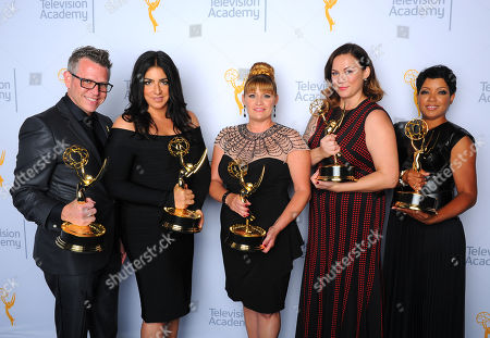 """Monte C. Haught, from left, Michelle Ceglia, Daina Daigle, Amy Wood and Sherri B. Hamilton, winners of the award for outstanding hairstyling for a limited series or movie for """"American Horror Story: Freak Show"""", pose for a portrait at the Television Academy's Creative Arts Emmy Awards at Microsoft Theater, in Los Angeles"""