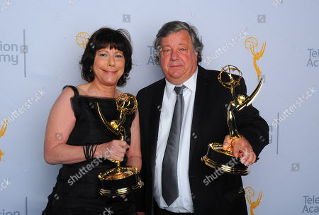 "Stock Image of Karen Goodman, left, and Kirk Simon, winners of the award for outstanding children's program for ""Alan Alda and the actor within you: a youngarts masterclass"", pose for a portrait at the Television Academy's Creative Arts Emmy Awards at Microsoft Theater, in Los Angeles"