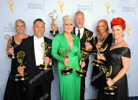 Jillian Erickson, from left, Mike Mekash, Eryn Krueger Mekash, Christopher Nelson, Lucy O'Reilly and Kim Ayers, winners of the award for make-up for a limited series or movie non-prosthetic for American Horror Story: Freak Show, pose for a portrait at the Television Academy's Creative Arts Emmy Awards at Microsoft Theater, in Los Angeles