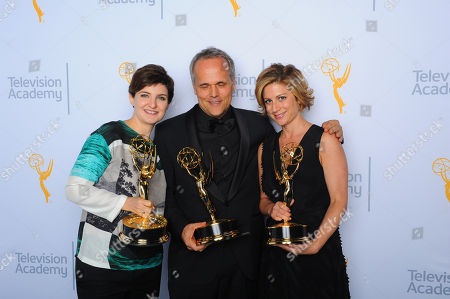 """Mathilde Bonnefoy, from left, Dirk Wilutzsky, and Laura Poitras, winners of the award for exceptional merit in documentary filmmaking for """"Citizenfour"""", pose for a portrait at the Television Academy's Creative Arts Emmy Awards at Microsoft Theater, in Los Angeles"""