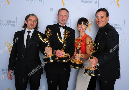 """Ronan Hill, from left, Richard Dyer, Onnalee Blank, and Mathew Waters, winners of the award for outstanding sound mixing for a comedy or drama series for """"Game of Thrones"""", pose for a portrait at the Television Academy's Creative Arts Emmy Awards at Microsoft Theater, in Los Angeles"""