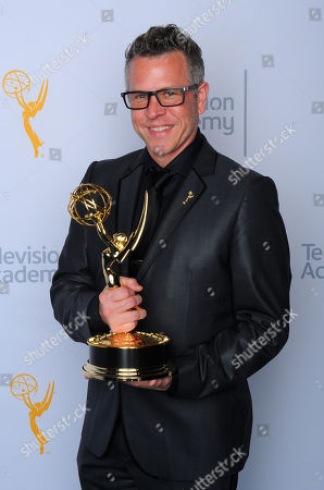 """Stock Photo of Monte C. Haught, winner of the award for outstanding hairstyling for a limited series or movie for """"American Horror Story: Freak Show"""", poses for a portrait at the Television Academy's Creative Arts Emmy Awards at Microsoft Theater, in Los Angeles"""