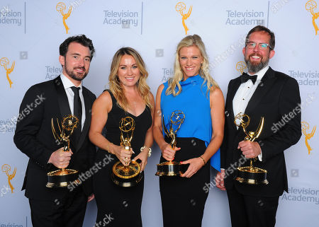 "Stock Photo of Rhys Thomas, from left, Erin Doyle, Lindsay Shookus, and Erik Keyword, winners of the award for outstanding variety special for ""The Saturday Night Live 40th Anniversary Special"", pose for a portrait at the Television Academy's Creative Arts Emmy Awards at Microsoft Theater, in Los Angeles"