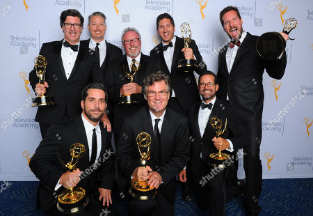 """Jeff Conroy, from back left, Joseph Boyle, Thom Beers, David Pritikin, Decker Watson, Johnny Beechler, from front right, Geoff Miller, and John Gray, winners of the award for outstanding unstructured reality program for """"Deadliest Catch"""", pose for a portrait at the Television Academy's Creative Arts Emmy Awards at Microsoft Theater, in Los Angeles"""